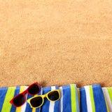 Summer beach border sunglasses background square format. Summer beach border sunglasses towel background square format Stock Photo