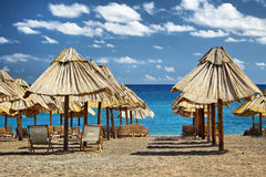 Summer beach with chairs and umbrellas Stock Photo