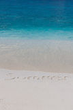 Summer beach and clear blue sea. Handwriting of summer word on the beach in Thailand Stock Images
