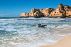 Summer beach with clear water. Portugal. Stock Photos