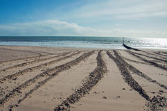 Summer beach and clouds in Dorset, UK. Royalty Free Stock Photography