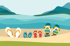 Summer beach with color flip flops. Family summer holiday. Stock Images