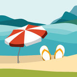 Summer beach with color flip flops and red umbrella. Stock Images