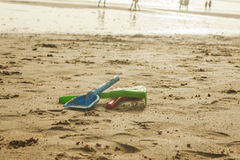 Summer beach colorful toys in the wet sand. Royalty Free Stock Image