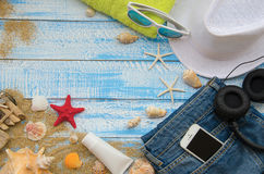 Summer beach concept. Summer accessories on a wooden background royalty free stock photos