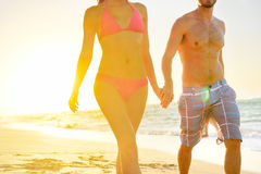 Summer beach couple romantic holding hands sunset Stock Photography