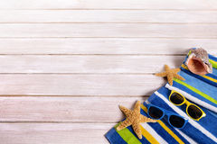 Summer beach decking wood background, towel, sunglasses, copy space Stock Photo