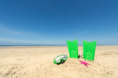 Summer beach. With diving equipent for children Stock Image