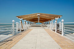Summer on the beach dock. A Day walk, alone on the empty touristic Wooden deck on Caspian Sea Stock Image