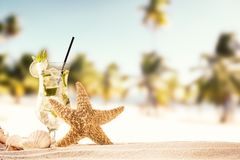 Summer beach with drink and shells Royalty Free Stock Photo