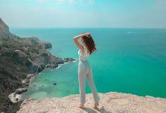 Summer beach fashion woman outfit. Beautiful traveller girl havi Stock Image