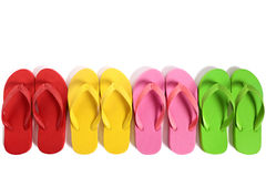 Summer beach flip flops row isolated on white background. Royalty Free Stock Photo