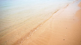 Summer beach  with golden sand and  blue sky Royalty Free Stock Photography