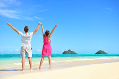 Summer beach happy free couple cheering on travel Stock Photo