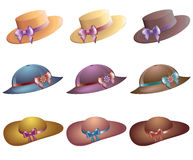 Summer beach hats. Summer beach collection of stylish colored hats. Vector set of hats with colored ribbons and decorations with flowers. Clip on a white royalty free illustration