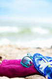 Summer Beach Holiday. Fuschia Towel, Sunglasses, Jelly Sandals l Royalty Free Stock Photography