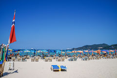 Summer Beach Holiday on Patong Beach Relax in the sun on the sun loungers under the beautiful travel background umbrella Stock Photos