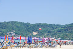 Summer Beach Holiday on Patong Beach Relax in the sun on the sun loungers under the beautiful travel background umbrella Royalty Free Stock Image