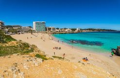 Summer beach holiday at seaside of Cala Ratjada on Majorca island, Spain. Mallorca beach Son Moll in Cala Rajada, beautiful seaside on Mallorca island, Spain Royalty Free Stock Images