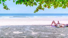 Summer beach holiday vacation concept. Young woman relax on the. Beach. Happy island lifestyle. Large space for your text Royalty Free Stock Photo