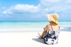Summer Beach Holiday Woman relax on the beach in free time royalty free stock photography