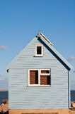 Summer beach house by the sea. Beach hut by the sea with solar panels and view of the dorset coast stock image