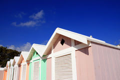 Summer beach huts on blue sky Stock Photo