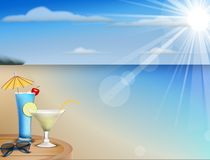 Summer beach juice and  sunglasses Royalty Free Stock Photography