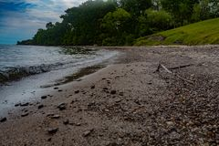 Summer Beach, Lake Erie Ohio. Beach With Rocks And Green Forest In Background, Lake Erie Ohio stock image