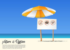 Summer beach landscape with No Mobile phone sign and orange beach  umbrella on blue gradient sky background. Stock Image