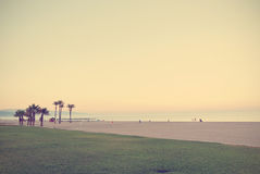 Summer beach landscape at sunset; retro Instagram style Royalty Free Stock Photos