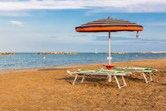 Summer beach landscape with umbrella and beach chairs Stock Images