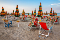 Summer beach landscape with umbrellas and beach chairs Royalty Free Stock Photos