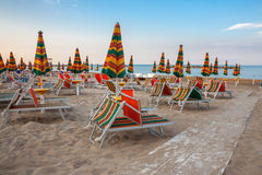 Summer beach landscape with umbrellas and beach chairs Royalty Free Stock Images