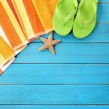 Summer beach objects border, flip flops, starfish blue wood background copy space. Summer beach objects border, flip flops, copy space, blue background royalty free stock photo