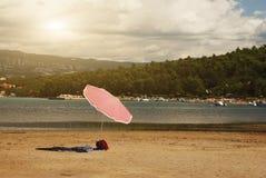 Summer beach. Parasol on summer beach in Croatia Stock Images