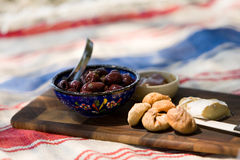 Summer beach picnic. A cheese olive and fig plate picnic Stock Image