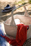 Summer beach picnic. A white picnic basket at the beach Royalty Free Stock Image