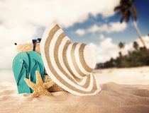 Summer beach with red sandals and shells Royalty Free Stock Images