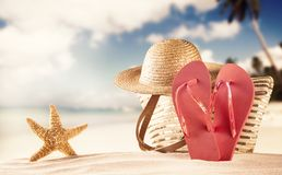 Summer beach with red sandals and shells Royalty Free Stock Photography