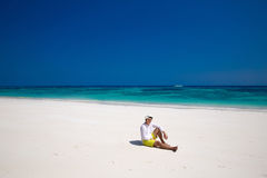 Summer beach. Relax. Successful handsome man in hat resting on e Stock Photo