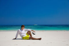 Summer beach. Relax. Successful handsome man in hat resting on e Royalty Free Stock Photos