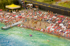 Summer beach. Resting people on the summer beach miniature Royalty Free Stock Images