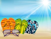 Summer beach sandals colorful flip- flops with sunglasses Stock Image