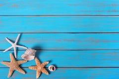 Summer beach seashore background starfish blue old wood paint peeeling stock photo
