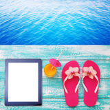Summer beach, set of summer accessories and tablet. Workplace for freelancer Stock Images