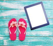 Summer beach, set of summer accessories and tablet. Workplace for freelancer Stock Photos
