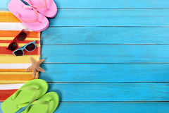 Summer beach side border background, sunglasses, flip flops, copy space. Summer beach objects border, sunglasses, flip flops, copy space royalty free stock images