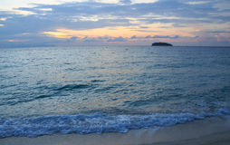Summer beach and splash wave water surface in evening, Lipe Thailand Royalty Free Stock Photo