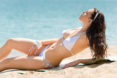 Summer beach stunning woman sunbathing in bikini Stock Image